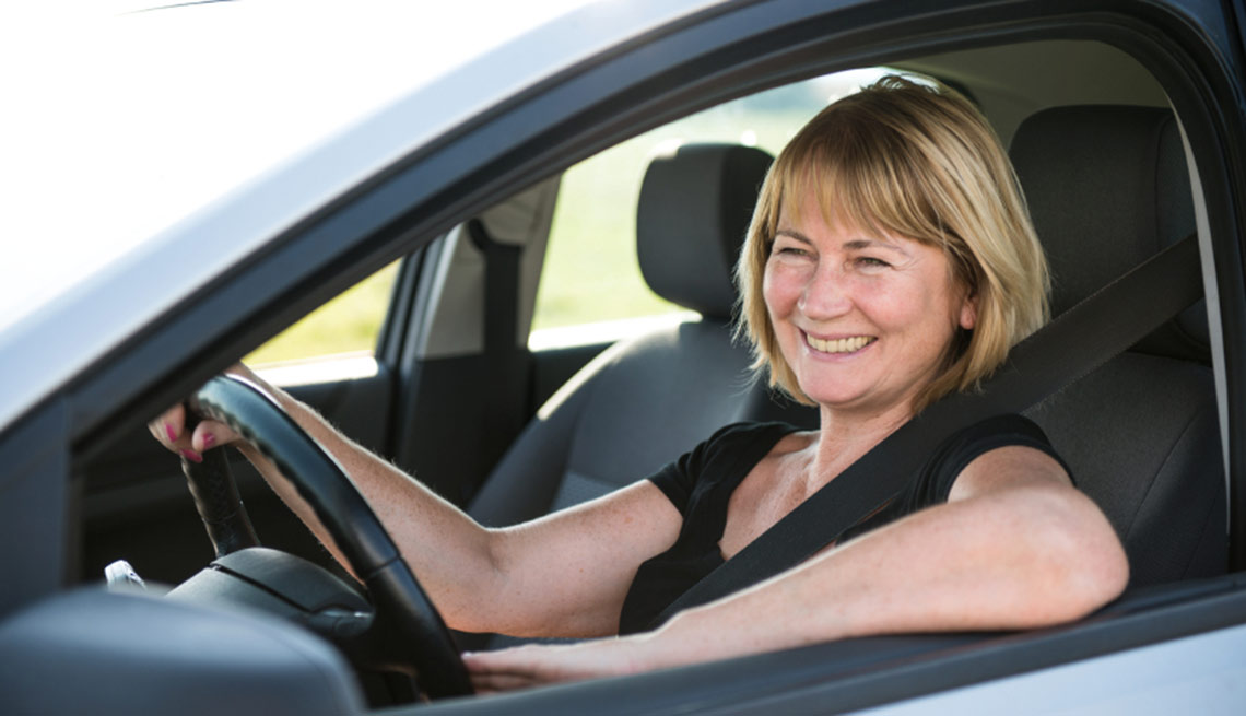 Mature woman driving car