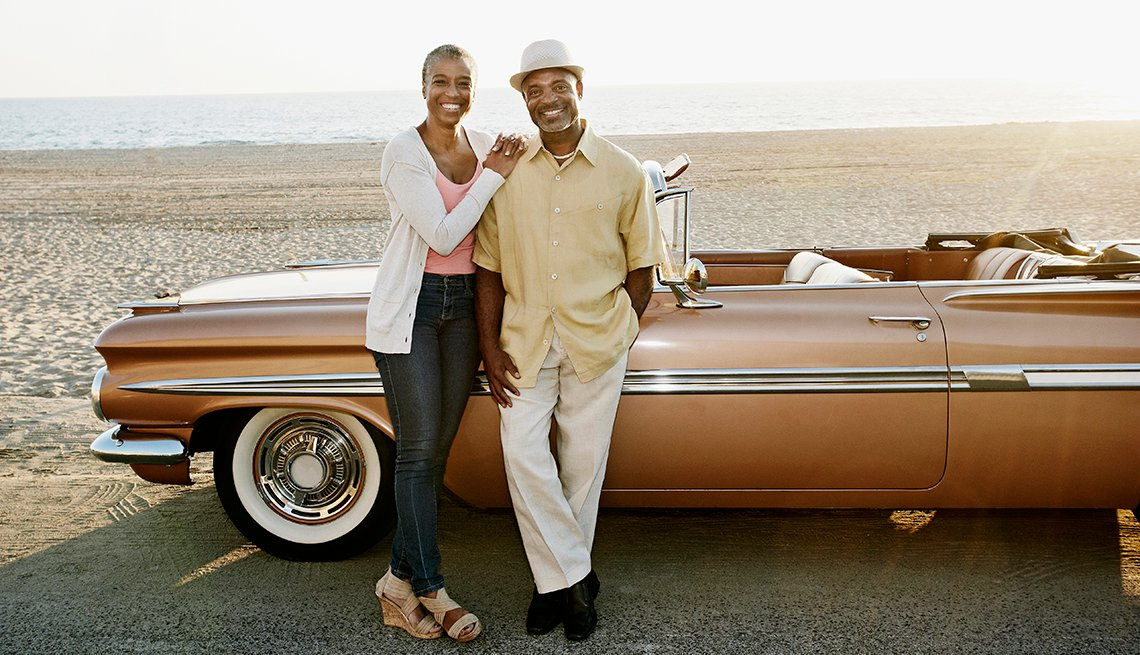 Couple with convertible on the beach, Pros and Cons of buying convertibles