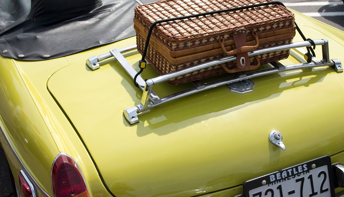 Suitcase on luggage rack, Limited convertible storage space, Pros and Cons of Buying a Convertible