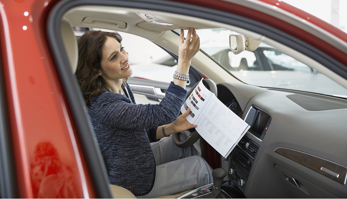 Woman looks at car features, Convertible safety improvements, Pros and Cons of Buying a Convertible