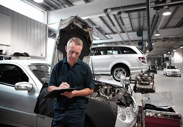 Mechanic working in auto repair shop,6 things you need to know about buying and owning a convertible