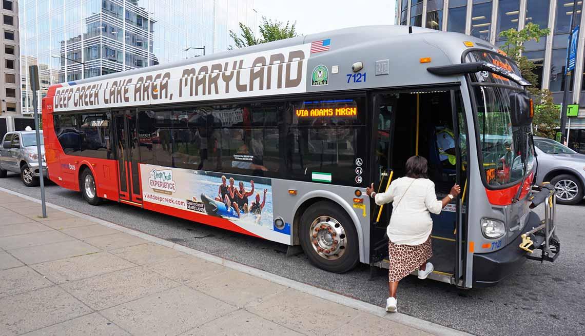 Woman boarding bus