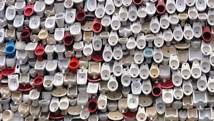 Toilet Waterfall - rows of toilets suspended to create a waterfall like wall - Toilets around the world