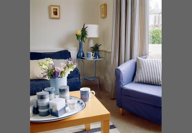 Cortinas de rayas verticales - Decorar espacios pequeños con familias grandes