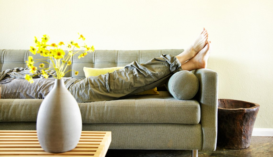 Woman Lying On Sofa In Her Home, AARP Home And Family, Home Improvement, How To Apply Feng Shui