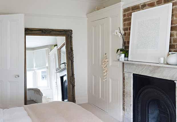 Claves para reflejar el estilo minimalista en tu hogar - Espejo de piso