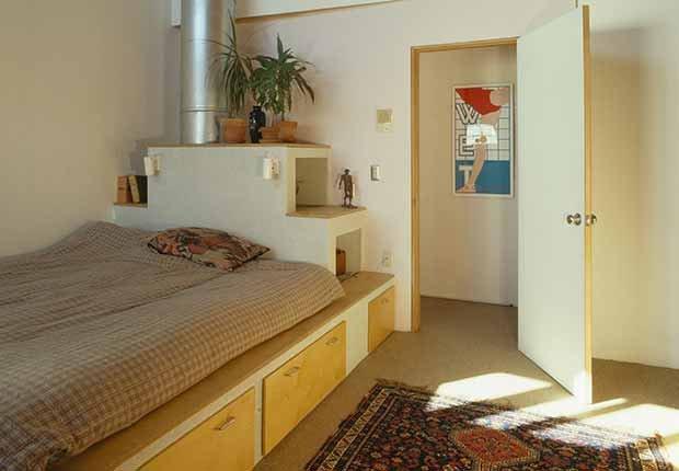 Claves para reflejar el estilo minimalista en tu hogar - Cama con compartimiento para guardar cosas