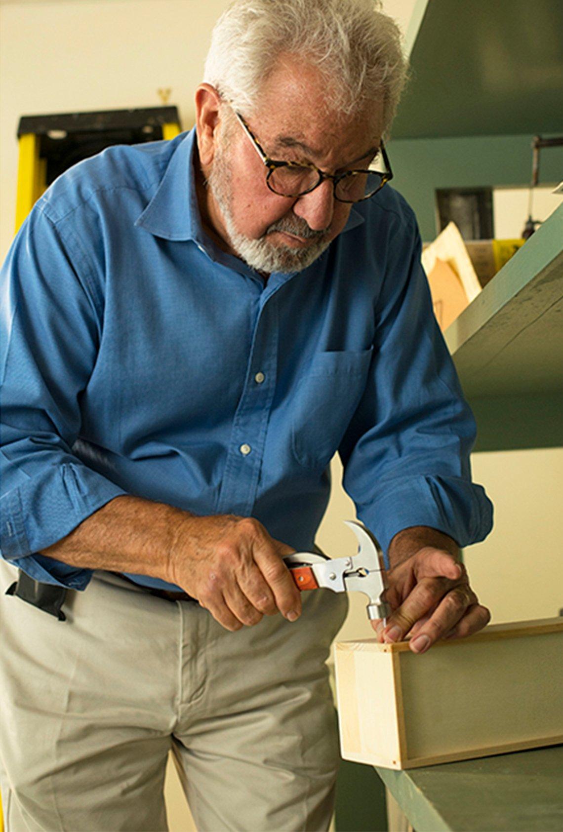 Bob Vila hammering a nail