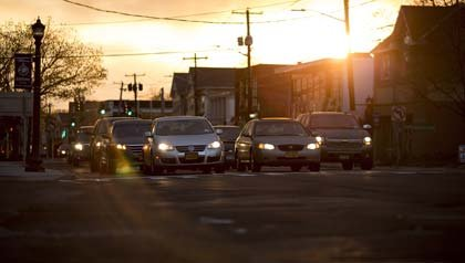 Cars intersection sunset, reduce traffic AARP New York