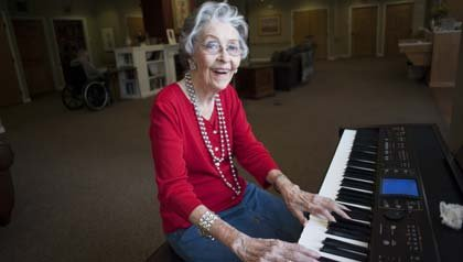 Sharla Lee plays the piano at the Sagecrest Alzheimer's Care Center in San Angelo.