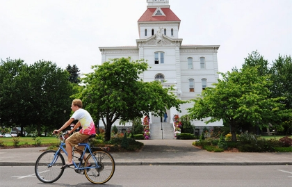 Riding a bike in Corvallis, OR. 10 Great Small Cities for Retirement.