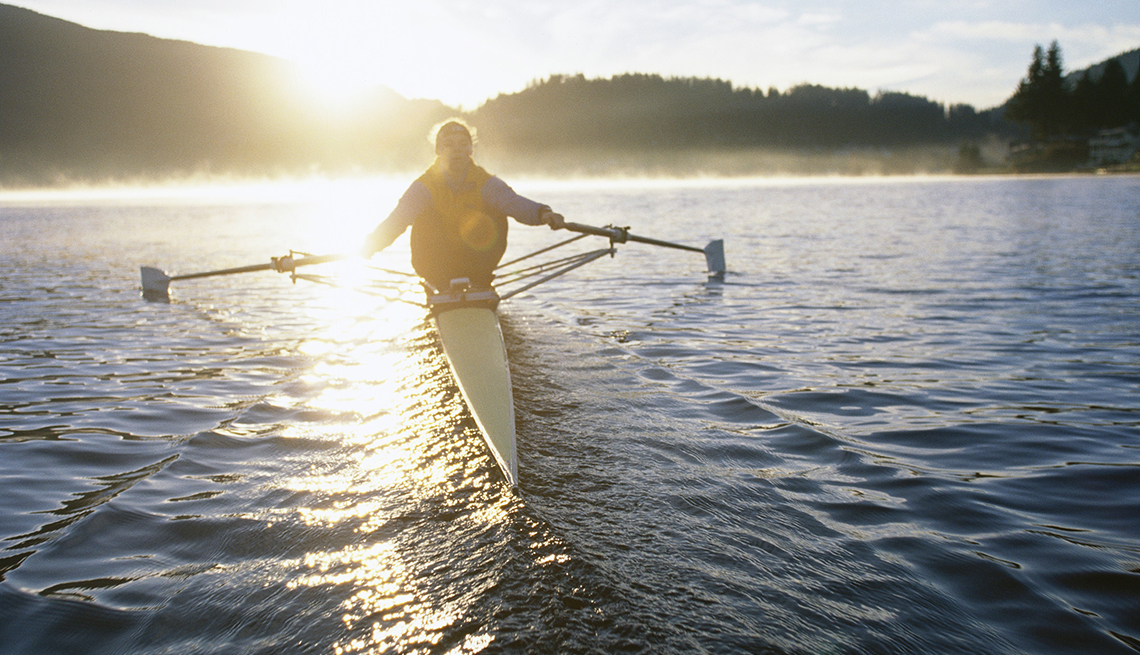 Woman rows on a river.