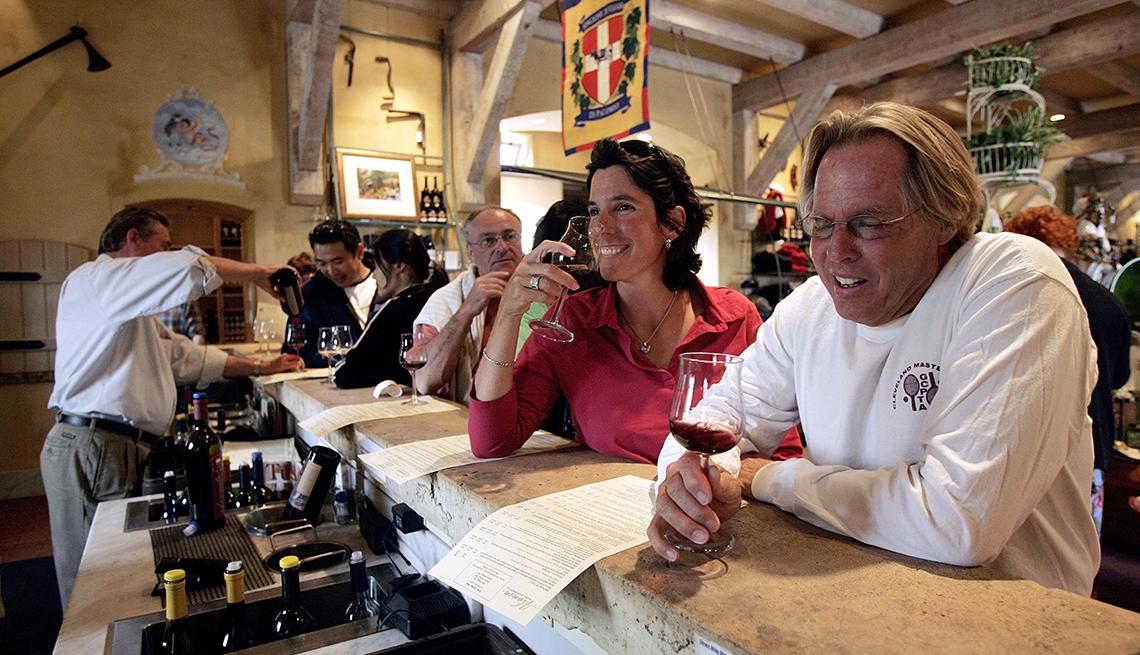 Couple enjoy wine at bar.
