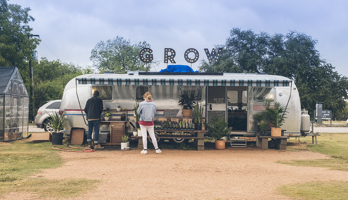A converted airstream tralier has become the grow plant store in an open lot in Fort Worth, Texas