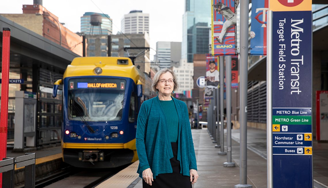 Woman Lucy Galbraith standing at a metro transit center in Minneapolis Minnesota