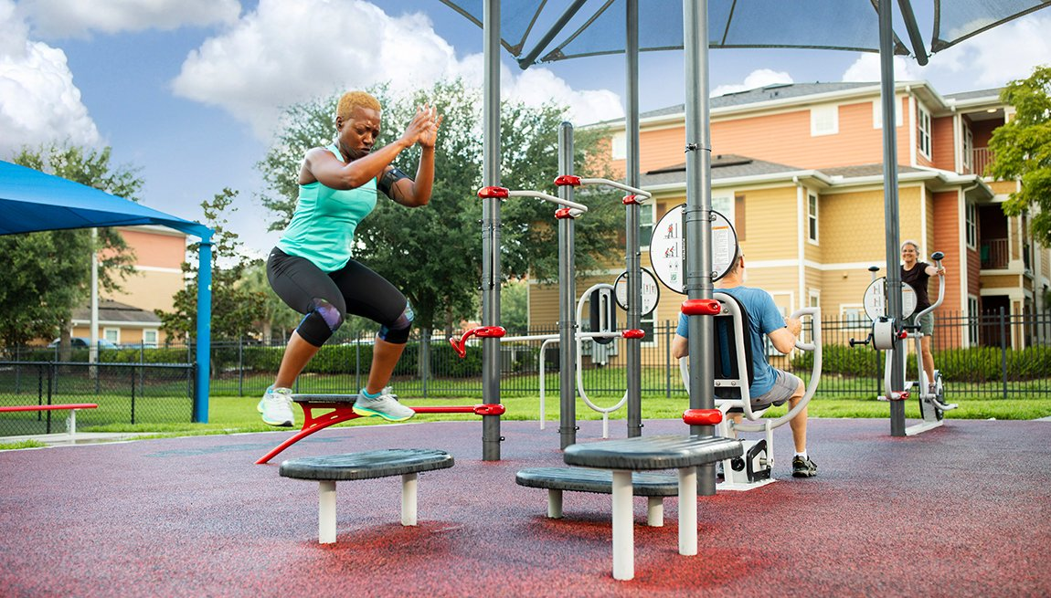 item 3, Gallery image. From left to right, Tamara Brooks, Daniel Belgrad and Catherine Valentine exercise at AARP's FitLot Park in St. Petersburg, Florida. The FitLot is the first of the kind built by AARP in the country.