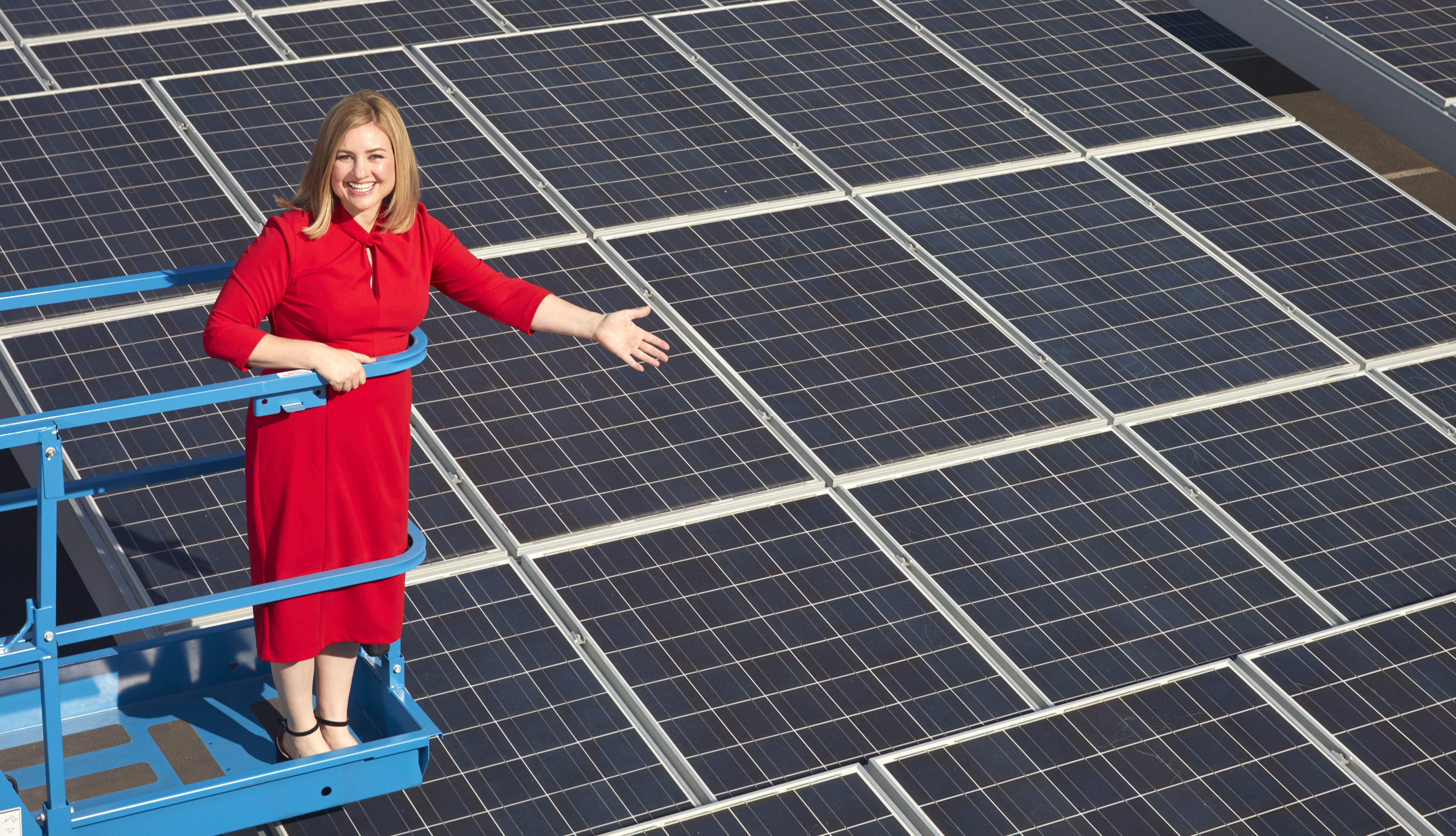 phoenix mayor kate gallego shows off a roof fitted with solar panels