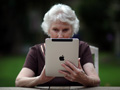 How to pass your digital information- photos, text messages, and e-mails- down to your heirs- a senior woman uses her iPad