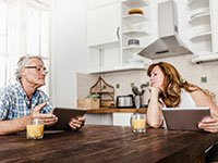 couple looks at AARP's new iPad app