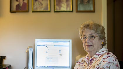 Sanny Moore, checks her Facebook accountto keep track of far-off family members. AARP Missouri