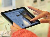 Woman tries out new iPad mini.