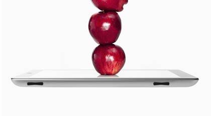 Manzanas sobre una tableta digital - 5 mejores aplicaciones en español para el mantenimiento de una dieta saludable