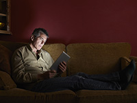 Man watching TV show on digital tablet.