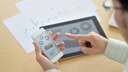 Businessmen in the office, using smartphone and tablet, Innovation@50+ (Getty Images)