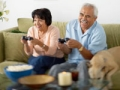 Couple playing video games together. (Lew Robertson/Corbis)