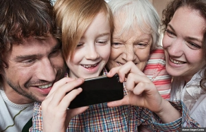 Three generation family with boy having fun with smart phone, Five Things You Should Know About Social Media (Marcel Steger/Corbis)
