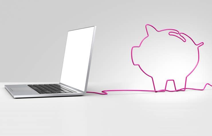 Computador portátil con una ilustración de una alcancia - Consejos para comprar en línea.