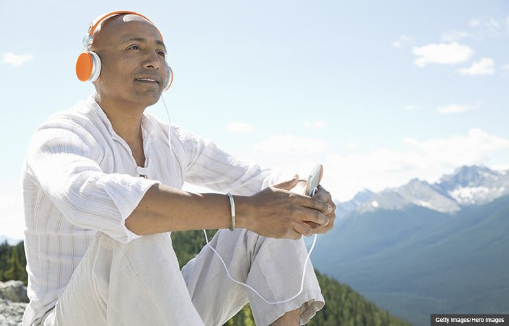 Mature man listening to music outdoors (Getty Images/Hero Images)