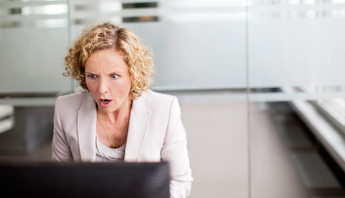 Surpised woman in office, Following An Internet Ad