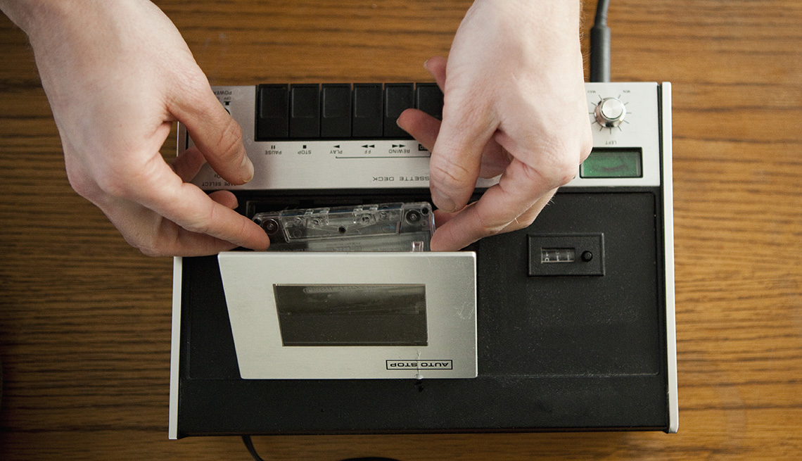 Hands Inserting A Tape Into A Tape Recorder, AARP Home And Family, Personal Technology, 13 Items That Have Been Replaced By The Smartphone
