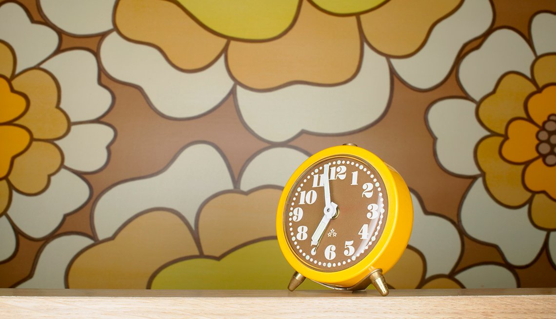 Yellow Alarm Clock On Table, AARP Home And Family, Personal Technology, 13 Items That Have Been Replaced By The Smartphone