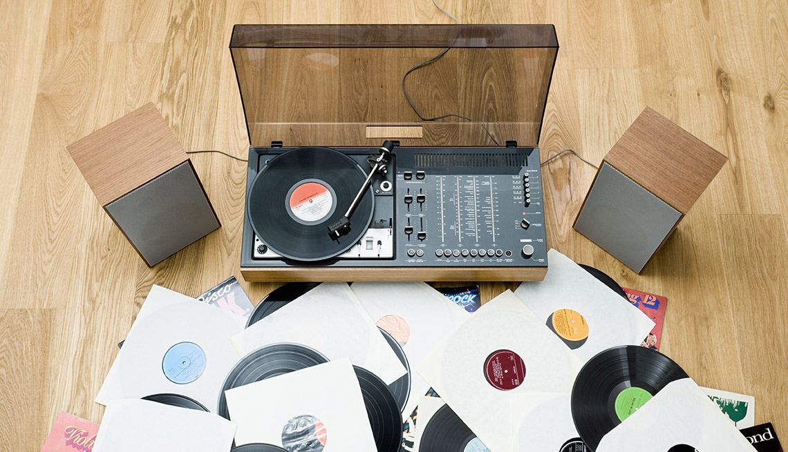 Record Player And Records On Floor, AARP Home And Family, Personal Technology, 13 Items That Have Been Replaced By The Smartphone