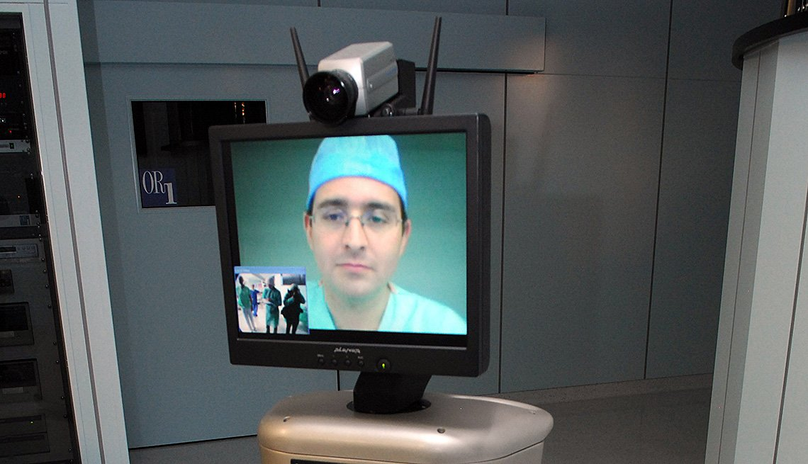 Computer Screen On Top Of Robot With Doctors Face, AARP Home And Family, Personal Technology, Virtual Doctor Visits