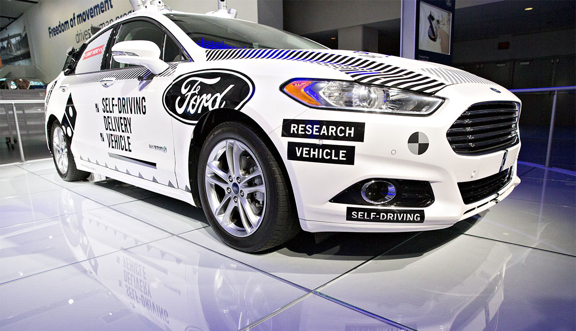 A Ford Fusion self-driving delivery vehicle at 2018 North American International Auto Show