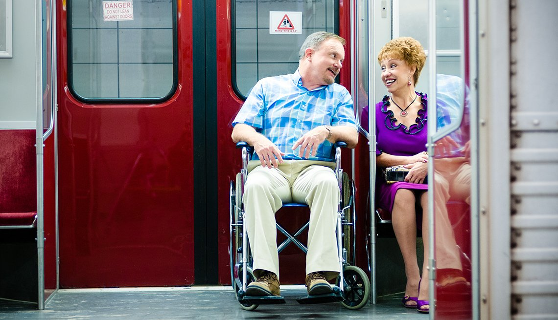 Couple riding in subway car