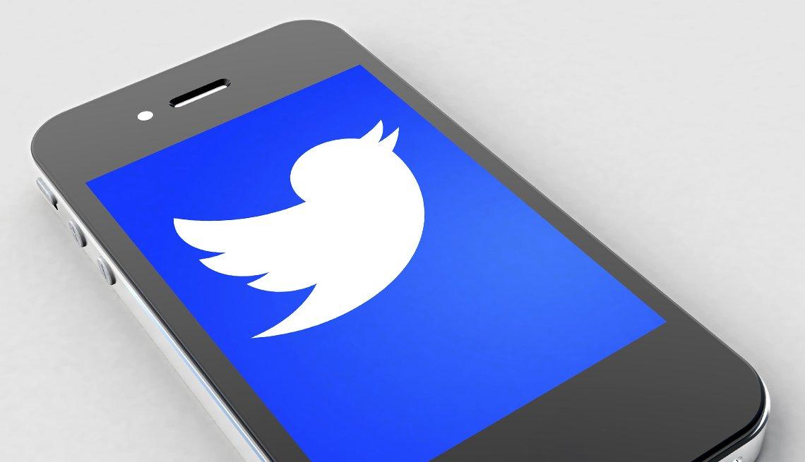twitter's logo on a smart phone