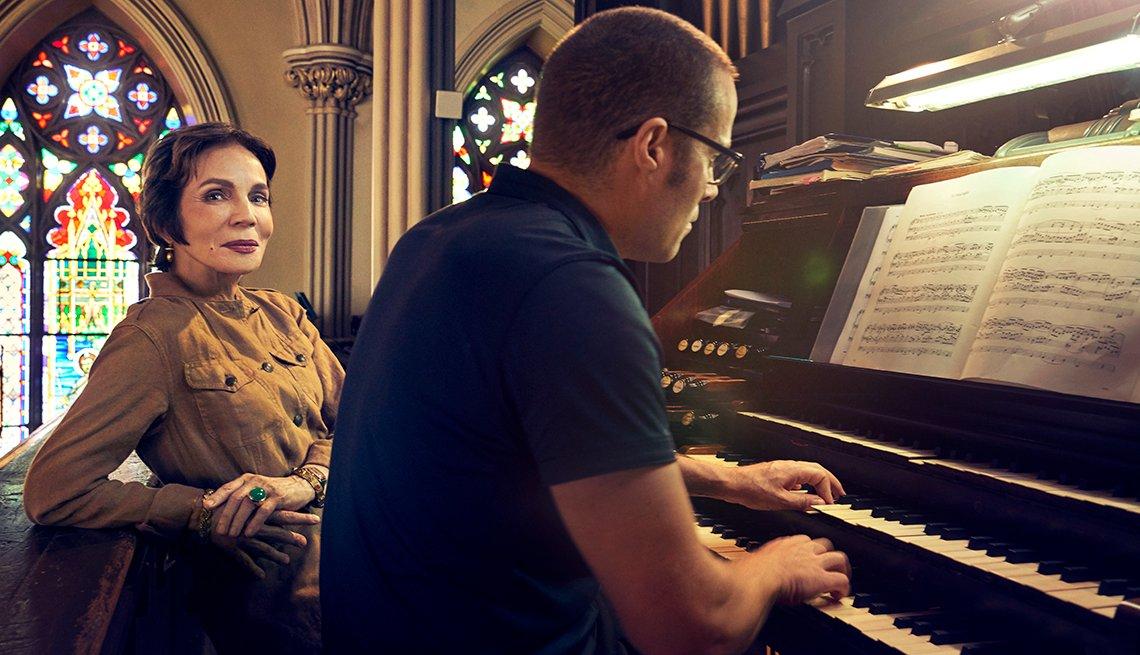 Anne Marie Riccitelli and Jared Lamenzo sitting at an organ.