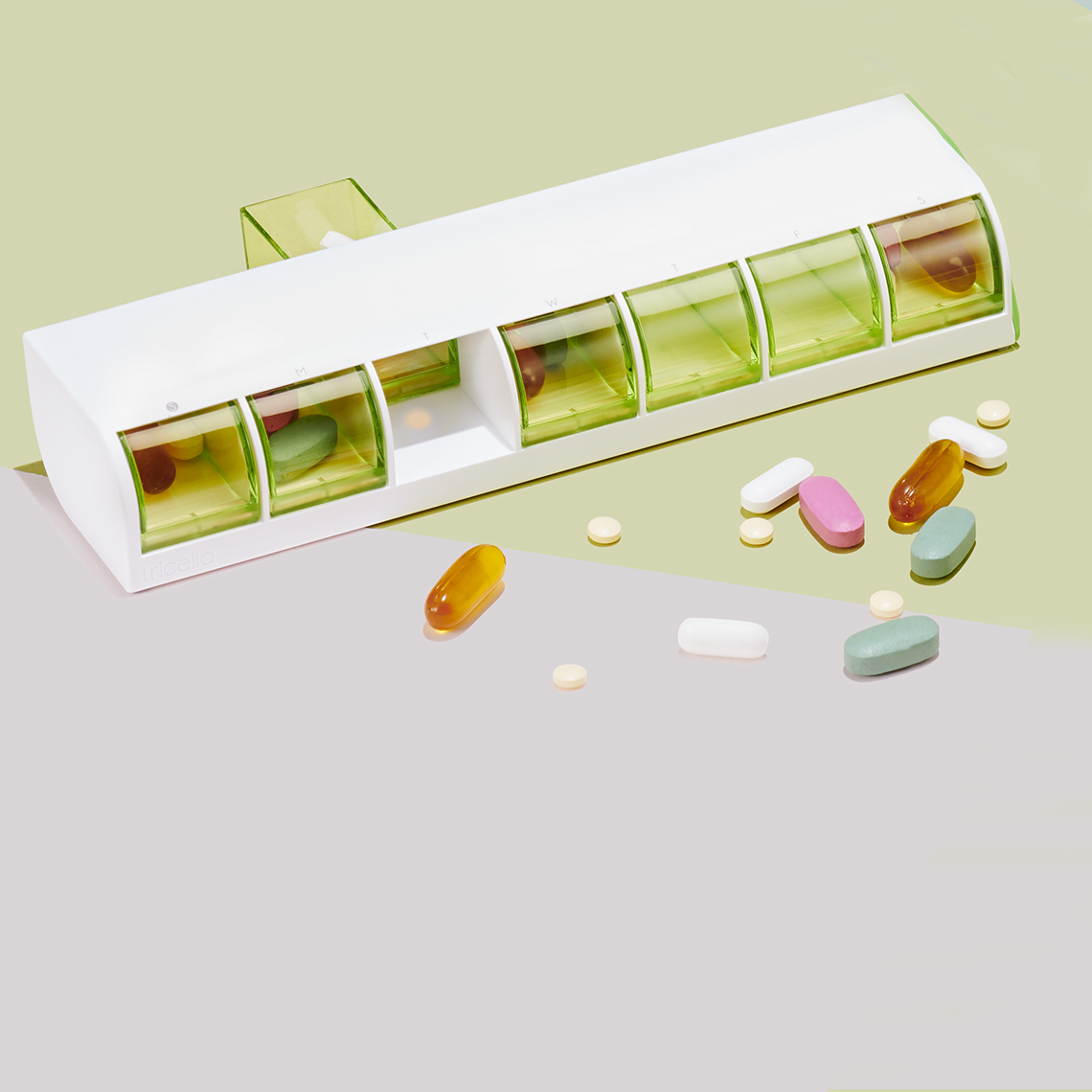 A pill container with various pills