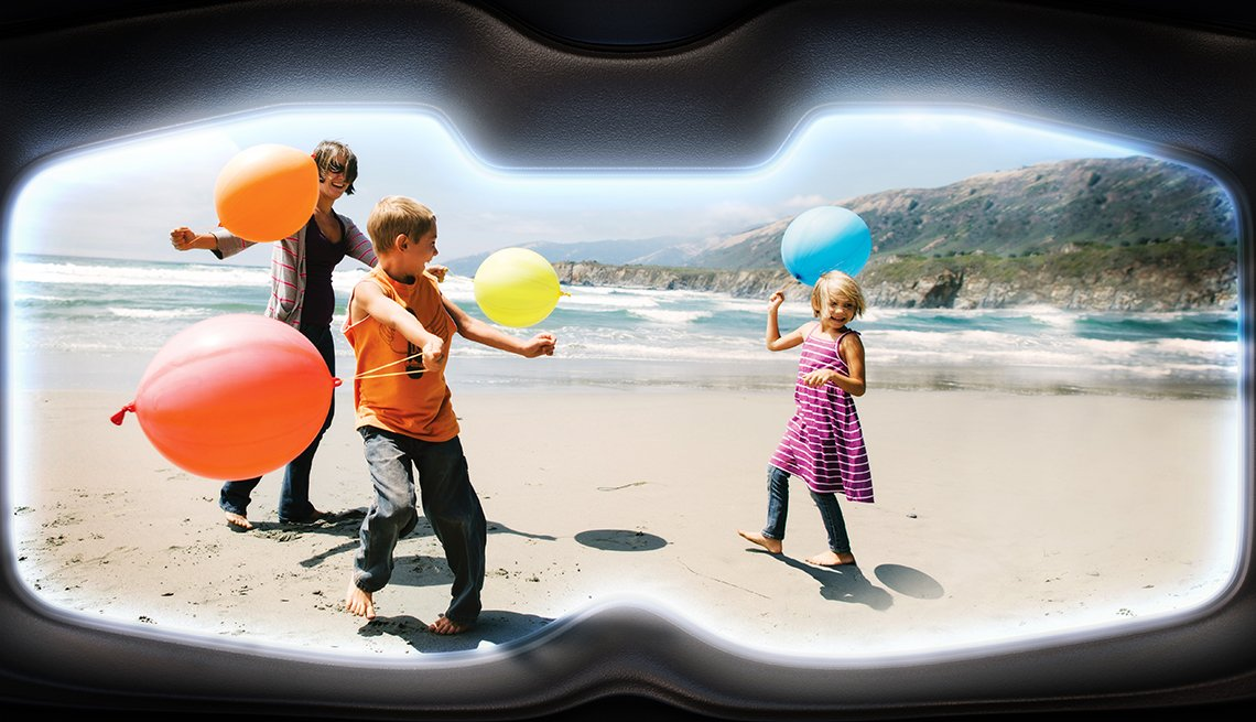 A photo of children on a beach as seen through VR goggles.