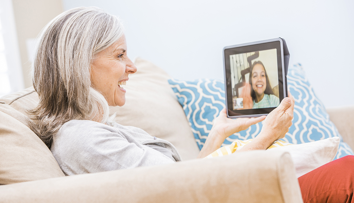 A grandparent on a video chat with a grandchild