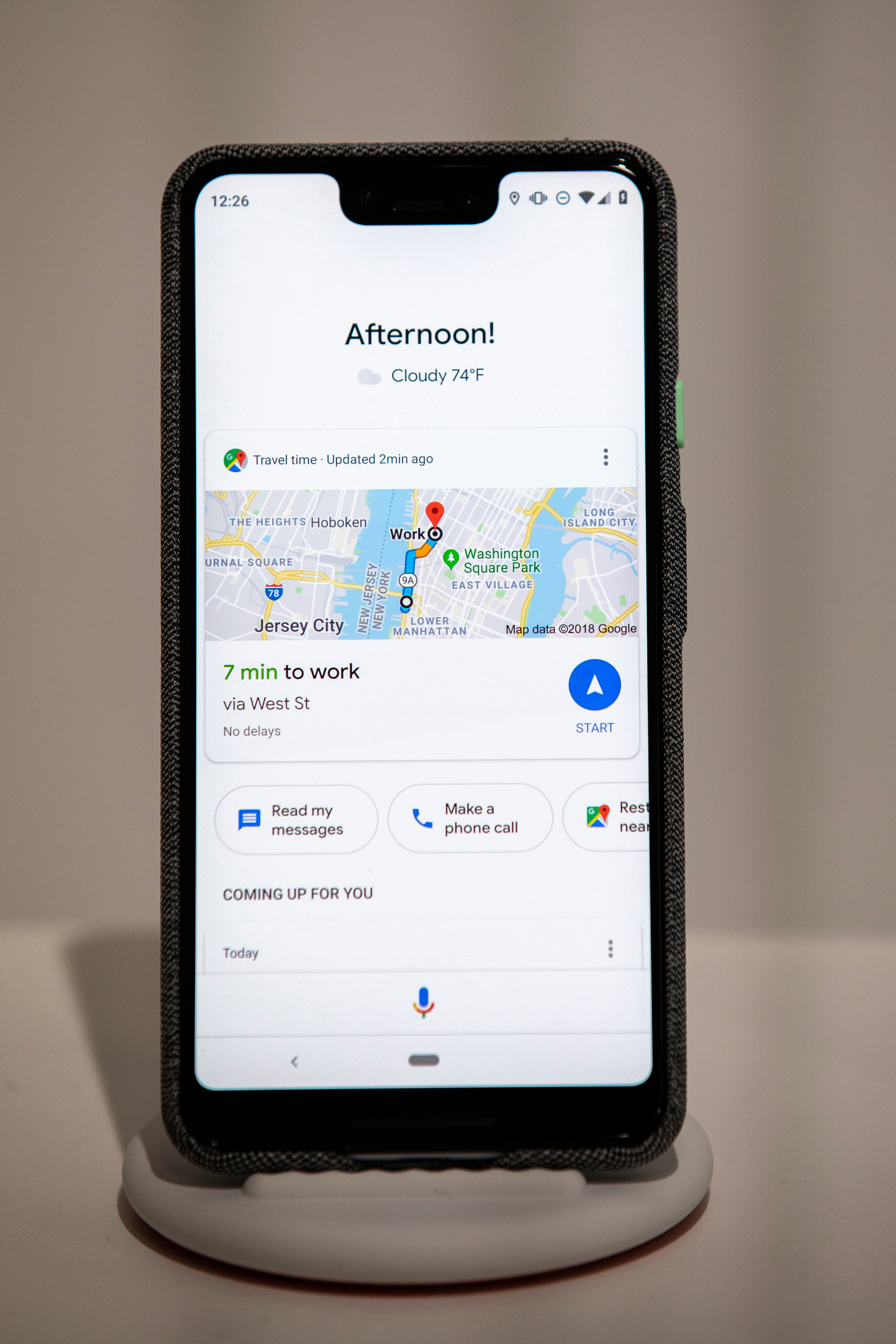 A picture of the Google Pixel 3 XL smartphone displaying tasks like, time to work, read my messages and more