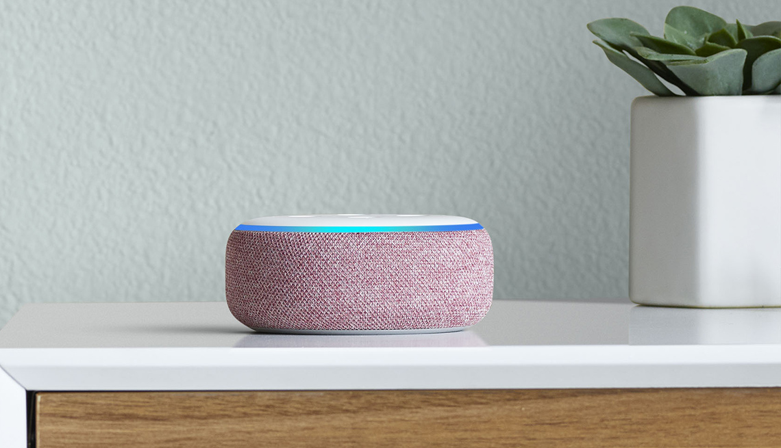 item 1 of Gallery image - Amazon Echo Dot smart speaker device on a countertop next to a plant