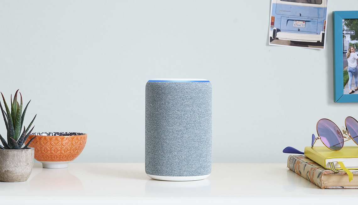 item 3, Gallery image. Amazon Alexa Echo Plus on a wooden table with green plants in the background