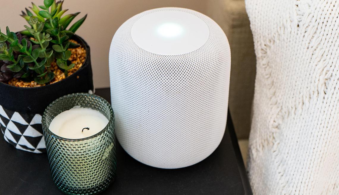 Apple HomePod in living room setting.