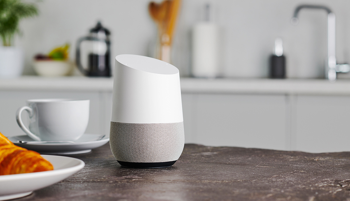 item 2 of Gallery image - A Google Home smart speaker photographed on a kitchen counter, taken on January 9, 2019.