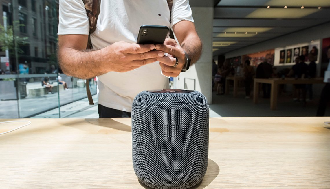 A customer uses his iphone to photograph the new HomePod during the launch of the HomePod at the Apple Store on February 9, 2018 in Sydney, Australia. Apple's latest innovation, released in the US, UK and Australia today, is a smart speaker and digital as
